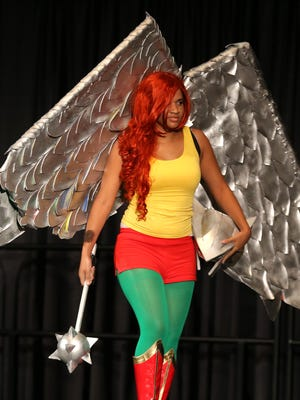 Mariah Manvel posed as Hawkgirl, while participating in the costume contest at Gen Con on Aug. 16, 2014, at the Indiana Convention Center in Downtown Indianapolis.