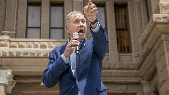 Michael Quinn Sullivan of Empower Texans, shown speaking in 2019 at the state Capitol, said in a statement he apologized to Gov. Greg Abbott for comments made by the group's staffers.