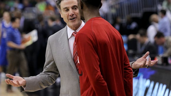 U of L head coach Rick Pitino instructs Russ Smith before the start of the second half against St. Louis last Saturday.