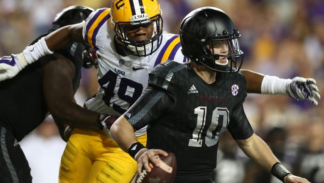 LSU's Arden Key (49) pressures Texas A&M quarterback Kyle Allen during the game last season in Tiger Stadium.