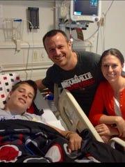 Brady Walz, with his uncle Jeff Walz and aunt Lauren