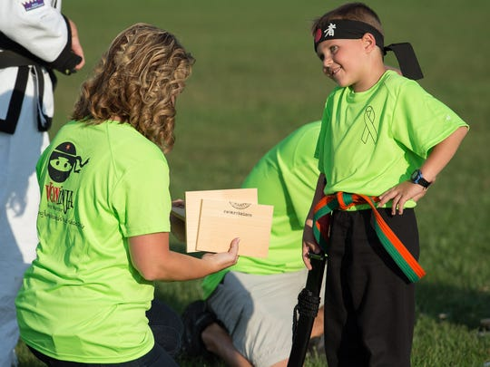Second-grader Von Kleiv, 7, talks with his mother, Gina, after breaking his first boards during a karate demonstration at Laps For Lymphoma fundraiser at Major George S. Welch Elementary School on Dover Air Force Base. Von was diagnosed with lymphoma in 2016.