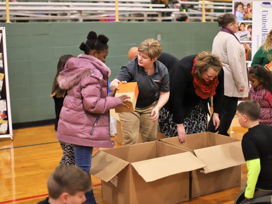 Springfield Boys & Girls Club children receiving brand-new,