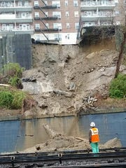 This photo shows a short retaining wall right behind/next to/east of the Hudson Line tracks.