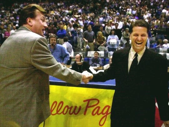 Memphis head coach John Calipari, right, shakes hands with longtime rival, Cincinnati head coach Bob Huggins, prior to Thursday's matchup between the two  Feb. 15, 2001, at the Pyramid in Memphis. (AP Photo/Lance Murphey)