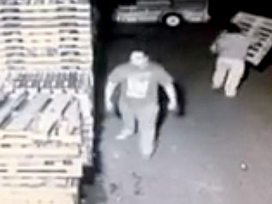 One of several men recorded stealing pallets from a