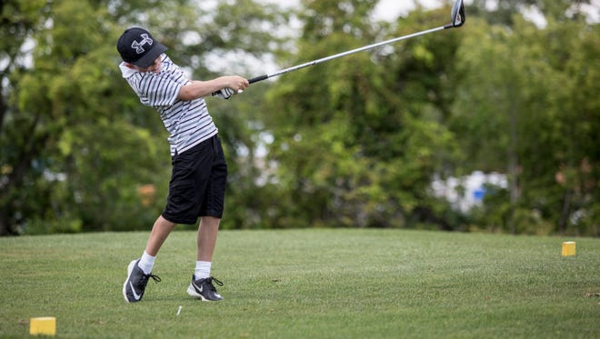 Kyren Bruno, 10, of Jeddo, tees off during the St. Clair Junior Golf Tournament Tuesday, August 9, 2016 at Pine Shores Golf Course in St. Clair.