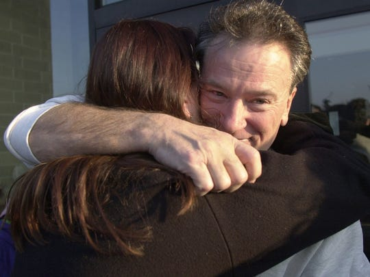 Mike Piaskowski hugs his daughter, Jenny Hruska, after he was freed on bail from Dodge Correctional Institution in Waupun in 2001.
