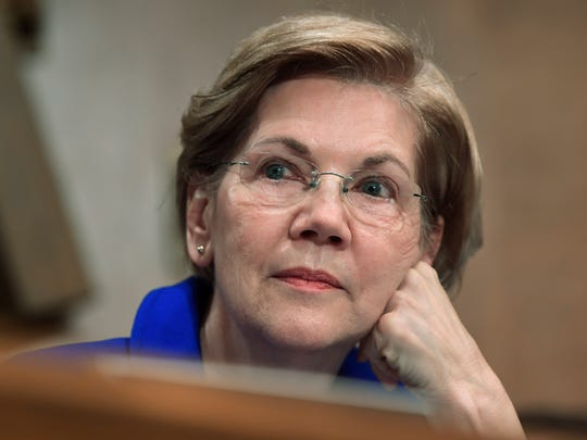 In this Dec. 5, 2017, file photo, Sen. Elizabeth Warren, D-Mass., waits to speak during a meeting of the Senate Banking Committee on Capitol Hill in Washington.