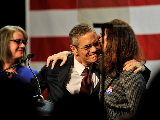 Mark Schauer, hugs his runningmate, Lisa Brown, right, during his concession speech at the Democratic election night party at the MGM Grand in Detroit.