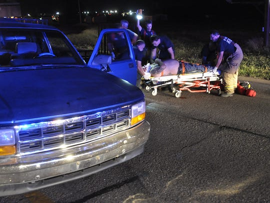 Emergency personnel tend to Rory Gregory in August of 2014 after he dragged a police officer who was clinging to his truck in an attempt to arrest Gregory for stealing an ATV.