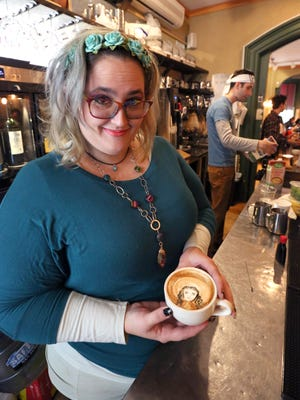 Barista Meagan Chauvot draws a face in a cappuccino at Art Cafe in Nyack Oct. 31, 2016.