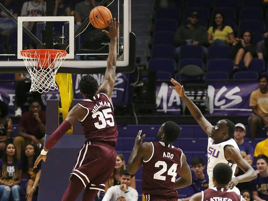 LSU Tigers forward Duop Reath (1) has a shot blocked in the first half against Mississippi State Bulldogs forward Aric Holman (35) at Pete Maravich Assembly Center. Mandatory Credit: Stephen Lew-USA TODAY Sports