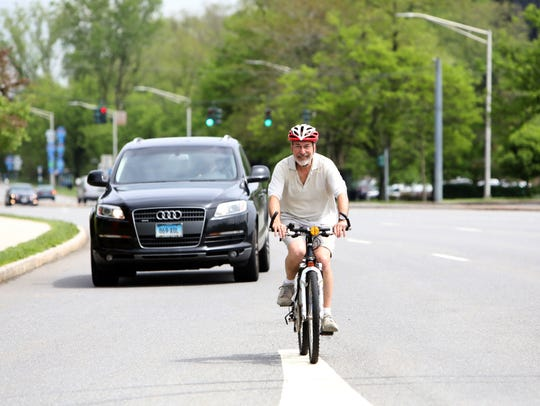 Dean Gallea of Tarrytown rides his bicycle on Route
