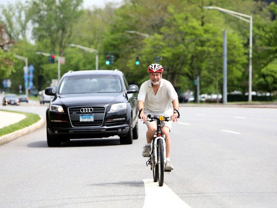 Dean Gallea of Tarrytown rides his bicycle on Route 119 in Tarrytown May 17, 2018. Gallea says Route 119 is a challenging road to navigate since there isn't marked bike lanes, especially during heavy traffic.