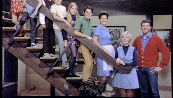 Ann B. Davis (third from right) who played Alice on