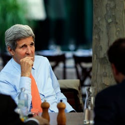 U.S. Secretary of State John Kerry, center, meets with his staff during the Iran nuclear talks in Vienna, Austria, Thursday, July 2, 2015.
