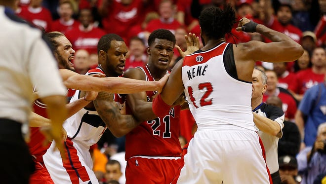 Washington Wizards forward Nene (42) scuffles with Chicago Bulls guard Jimmy Butler (21) in the fourth quarter in Game 3 of the first round of the 2014 NBA Playoffs at Verizon Center.