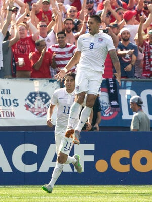 Clint Dempsey celebrates after scoring the game's opening goal.