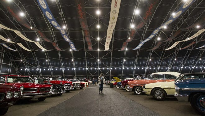 Lou Panuse, 91, looks at cars up for sale at the Barrett-Jackson car auction event at WestWorld in Scottsdale on Saturday, Jan. 14, 2017.
