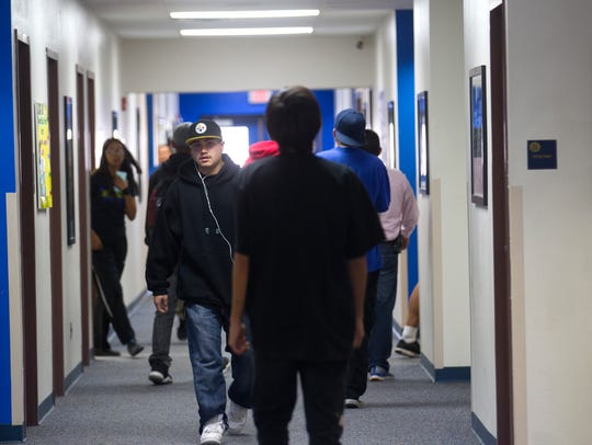 Students head to class last week at Charlie Yazzie Brown High School in Bloomfield.