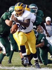 Colonia running back Eric LeGrand breaks through the J.F. Kennedy defensive line, Friday, September 7, 2007, in Iselin.