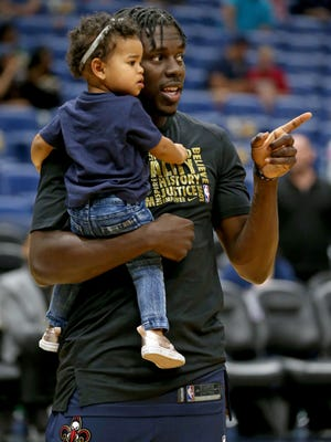 Feb 23, 2018; New Orleans, LA, USA; New Orleans Pelicans guard Jrue Holiday holds his daughter J.T. before their game against the Miami Heat at the Smoothie King Center.