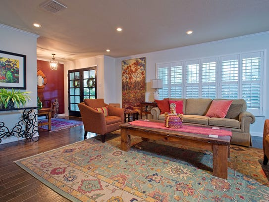 Double French doors lead into the front living space