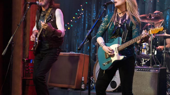 """Rick Springfield, left, as Greg and Meryl Streep, as Ricki, performing at the Flash at the Salt Well in TriStar Pictures' """"Ricki and the Flash."""" The movie opens Friday at Sun Valley Cinema 6."""