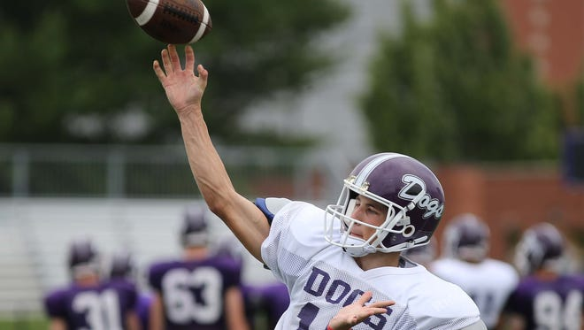 Brownsburg QB Hunter Johnson is seen during practice at the school Wednesday August 20, 2014.