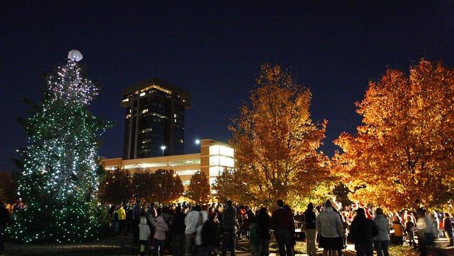 The Christmas tree shines among the lights at Jordan Valley Park.