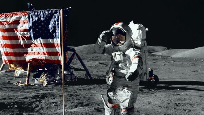 Apollo 17 astronaut Captain Gene Cernan salutes the U.S. flag on the surface of the moon in December 1972. He became the last man to walk on its surface so far.