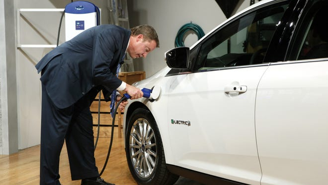 Executive Chairman Bill Ford charges the Ford Focus Electric
