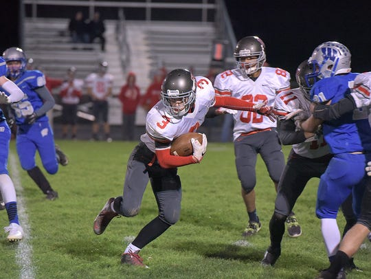 Buckeye Central's Jeff Hall runs the ball against Wynford