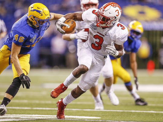Center Grove TrojansÕ Russ Yeast (3) takes off on a run against Carmel during the Class 6A state title game at Lucas Oil Stadium on Friday, Nov. 25, 2016.
