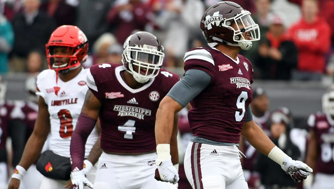 Montez Sweat (9) celebrates after a play during the first half of the game against the Louisville Cardinals.