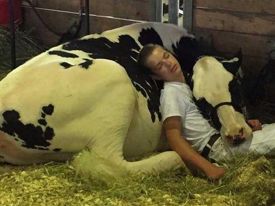 Mitchell Miner, 15, of Williamsburg, sleeps on his