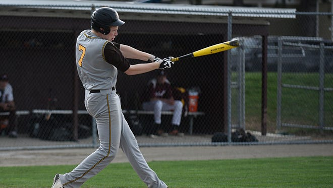 North Farmington's Graham Narins (7) takes his cuts Wednesday afternoon in OAA White Division action at Birmingham Seaholm.