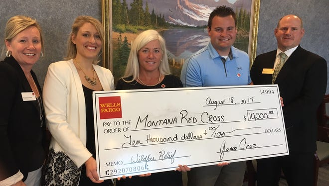 From left: Tammie Farren, Janna Cruz, Diane Wright, Red Cross board member Stephen Walter and Nathan Hoehn. The check presented is from Wells Fargo.