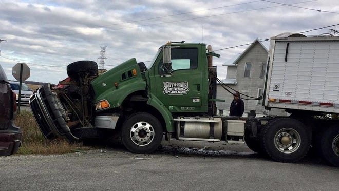 Crash between a tractor-trailer and a pickup Friday resulted in minor injuries.