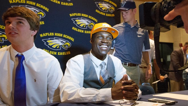 Naples High School's Carlin Fils-aime was among the school's athletes who signed National Letters of Intent Wednesday at the school. Fils-aime will play football at the University of Tennessee.