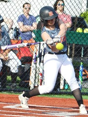 Hasbrouck Heights junior Kimberly Halpin taking a swing at a pitch against Paterson Charter last week.