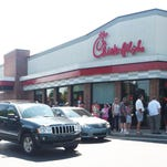 People line up outside and around the Chick-fil-A restaurant in Noblesville just before noon causing traffic congestion in the area. The popular restaurants saw big crowds Wednesday, August 1, 2012 as supporters turned out for an appreciation day organized by former Arkansas Gov. Mike Huckabee. Many of those in line were there to show support for the chain's president and his opposition to same-sex marriage. ( Amanda Silver / for the Star)