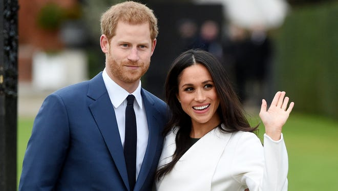 Britain's Prince Harry pose with Meghan Markle during a photocall after announcing their engagement in the Sunken Garden in Kensington Palace in London.