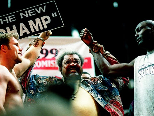 No. 10 Top 10 Sports Events: Boxing promoter Don King, center, introduces WBO heavyweight champion Henry Akinwande, right, and challenger Scott Welch during weigh-ins Jan. 10, 1997. The two will face each other in the inaugural boxing event in the new Nashville Arena.