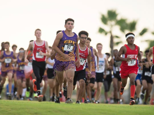 Fort Pierce Central's Bryan Vega, center, leads the start Thursday, August 31, 2017 of the 11th annual Wayne Cross High School Cross Country Invitational at Champion Turf Club at St. James in Port St. Lucie. To see more photos, go to TCPalm.com. CQ: Bryan Vega