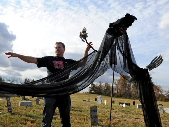 """Terror on the Trail"" organizer Matt Gibson gets the haunted graveyard ready in this file photo."
