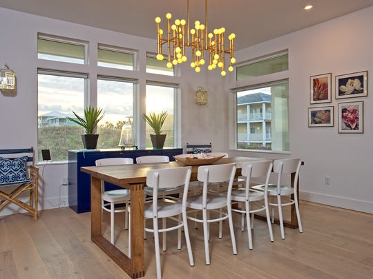 The wood floored dining area in the open living space