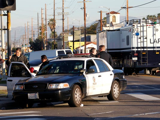 Man opens fire at LA police officers