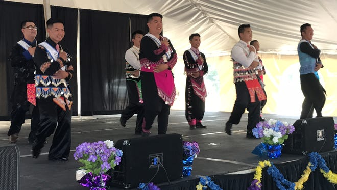 Contestants of the Mr. Hmong Royalty Pageant perform an opening dance July 29, 2017 in Wausau, Wisconsin.